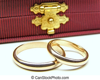 wedding rings - two golden wedding rings against elegant...