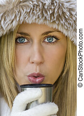 Warm Drink - A stunningly beautiful young blond woman...