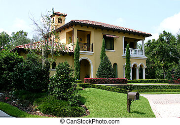 Upscale Home - Upscale yellow Spanish-style stucco home with...