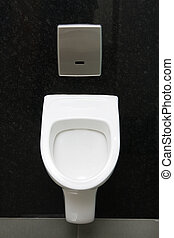 urinal - Clean Urinal on dark gray wall