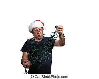 Tangled mess is a photo of a man in a Santa hat holding...