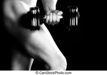 Nude Male Fitness - Nude male model with dumbbell over black...