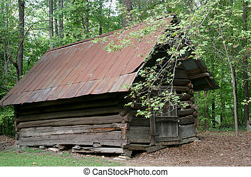 Old cabin in the woods - An old log cabin in the woods