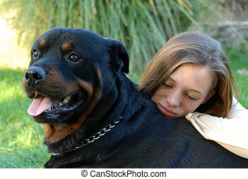 girl and rottweiler - young woman and her best friend...