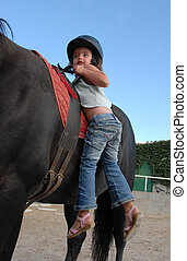 little girl and big horse - very young little girl on her...