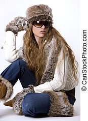 winter woman - stunning woman wearing winter outfit with fur...