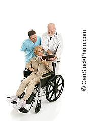 Disabled Senior Consults Docs - Senior woman in wheelchair...
