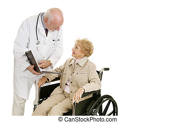 Doctor Patient Consultation - Disabled senior woman consults...