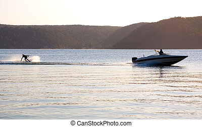 sunset waterski speed boat - sunset waterskiing wakeboarder...
