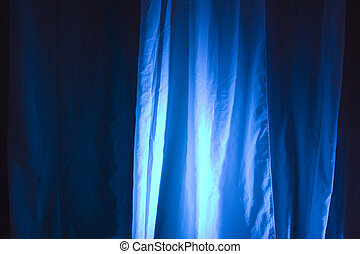 Spot Lights Against Stage Curtain