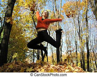 jump girl in autumn wood