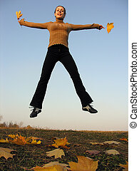 jump girl with autumn leaves