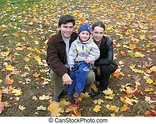 smile family on autumn leaves