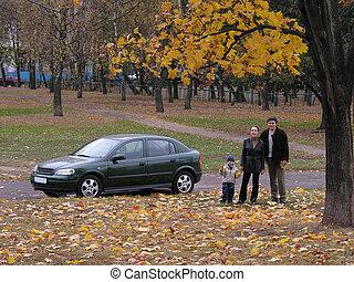 Family near the car
