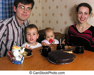 Family of four at the table