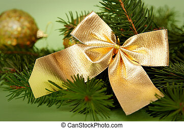Golden-green christmas de - Golden decorations and spruce on...