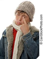 Sad Face - Sad, sullen,  pouting boy rubs an eye