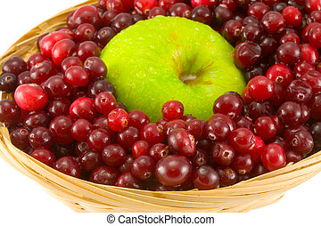 cranberries and apple - red cranberries and apple in crib...