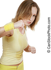 Watch out! - Sportive agressive blond girl in yellow fitness...