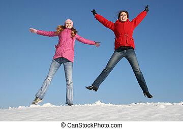 girls jumping. winter.