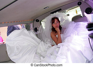 Unhappy bride in wedding car limousine
