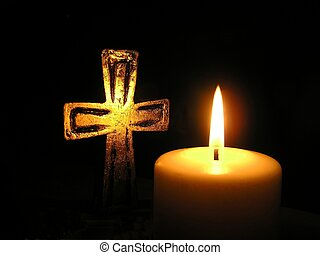 candle light and cross - Close-up of golden cross and candle...