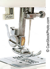 The sewing machine on white background