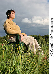 woman resting on meadow
