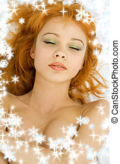 dreaming redhead with snowflakes - picture of dreaming...