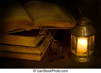 Key to dreamland  - Open antique books the darkness of night