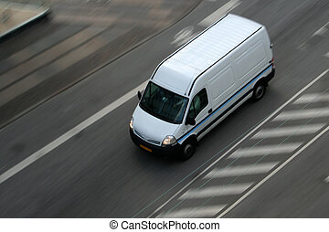 Delivery van on road - Fast moving truck on asphalt road