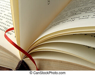 book with bookmark - open old book fragment with red...