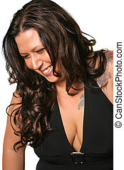 woman smiling - tattooed brunette woman smiling with eyes...