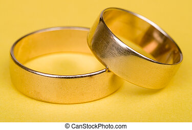 Wedding rings - Gold wedding rings on yellow light bacground