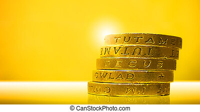 Pound Coins - Stack of five British Pound Coins.