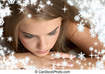 thoughtful girl with snowflakes - christmas portrait of...