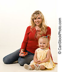 Mom and baby - Portrait of an attractive young mother and an...