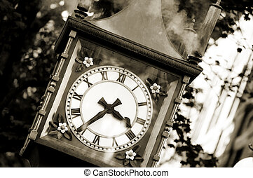 Gastown, Vancouver - Famous steam clock landmark in sepia in...