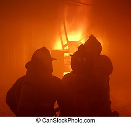 At the fire - Firefighters at the fire.