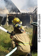 Holding the hose - Firefighters hold on to the hose while...