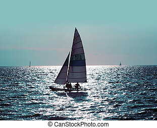 Sailing boat - 3 people on the sailing boat in the ocean