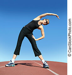 Exercising woman - Young pretty woman exercising on a...