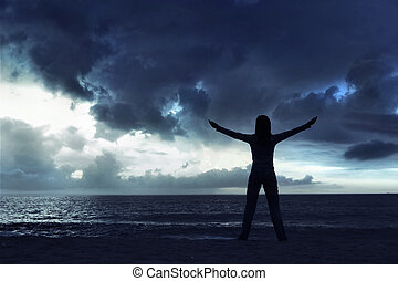 Thank you Nature - Woman silhouette relaxing on the beach at...