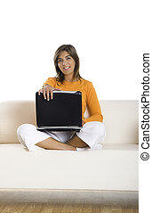 Working at home - Beautiful woman working at home holding a...