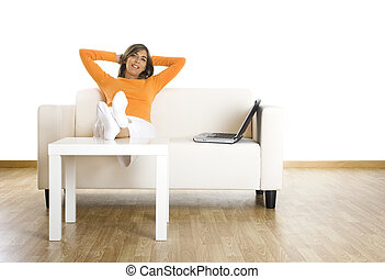 Pause after work - Beautiful woman laughing on the couch at...