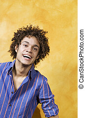 guy smiling - facial expressions: guy with curly hair...