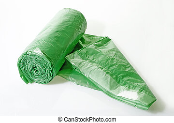 Trash bags rolled up on bright background
