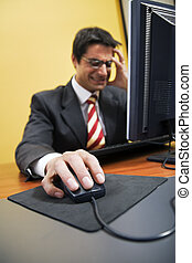 people at work: business man screaming at his PC. It got a...