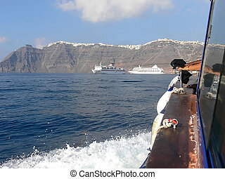 In front of santorini. - With an tuck beat from the cruise...