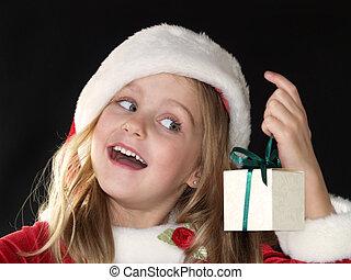 Christmas girl holding gift - little Christmas girl dressed...